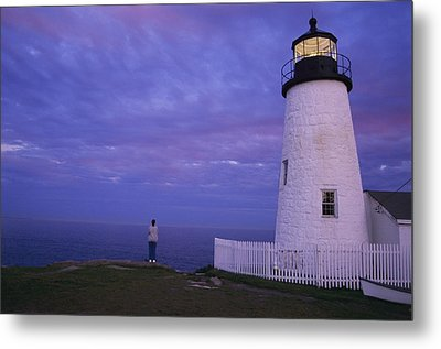 A Lighthouse Visitor Enjoys A Twilight Metal Print by Stephen St. John