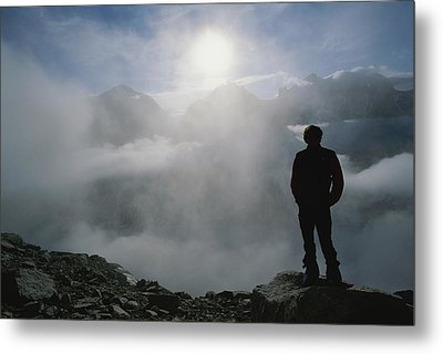 A Man In Silhouette Looking Metal Print