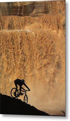 A Mountain Biker Pedals Past Rushing Metal Print by Bill Hatcher