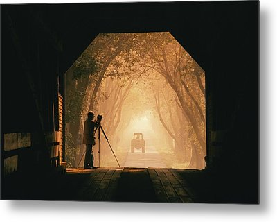 A Photographer Sets Up His Camera Metal Print by Richard Nowitz