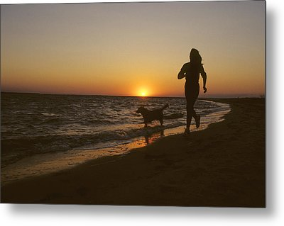 A Woman And Her Dog Running Metal Print