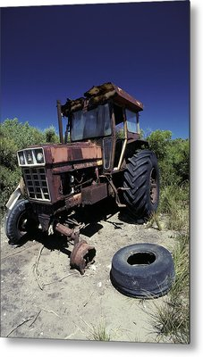 An Abandoned Tractor Rusts Away Metal Print by Jason Edwards