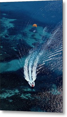 An Aerial View Of A Motorboat Towing Metal Print by Paul Chesley
