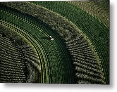 An Aerial View Of A Tractor On Curved Metal Print by Paul Chesley