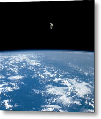 An Astronaut Propelled Above The Earth Metal Print by Nasa