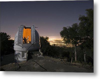 An Astronomer Works Inside A Dome Metal Print by Jim Richardson