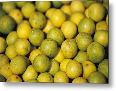 An Enticing Display Of Lemons Metal Print by Jason Edwards