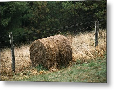 Barbed Wire Fence And Hay Roll Metal Print by Raymond Gehman