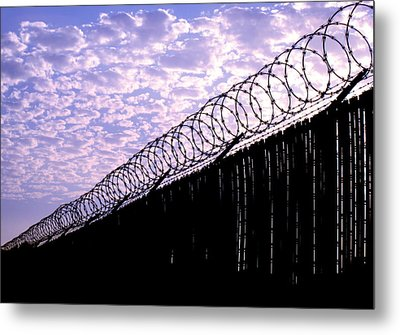 Metal Print featuring the photograph Blue Sunset And Barbed Wire by John King