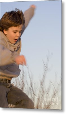 Boy Jumping Off Sand Dune Metal Print by Christopher Purcell