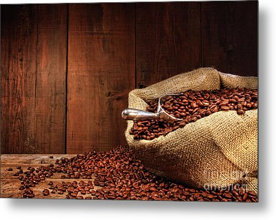Burlap Sack Of Coffee Beans Against Dark Wood Metal Print by Sandra Cunningham