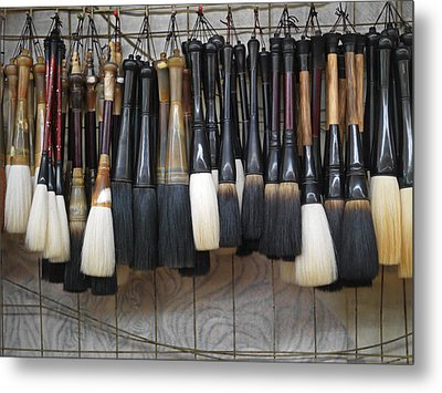 Calligraphy Brushes Hang On The Wall Metal Print by Justin Guariglia