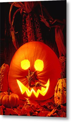Carved Pumpkin With Fall Leaves Metal Print by Garry Gay