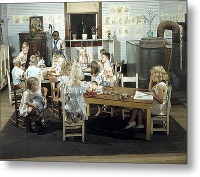 Children Play In A Day Nursery Metal Print by J Baylor Roberts