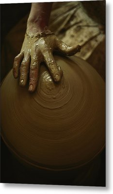 Close-up Of The Brown Muddy Hand Metal Print by Thomas J. Abercrombie