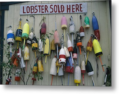 Colorful Lobster Buoys Hang On A New Metal Print by Stephen St. John