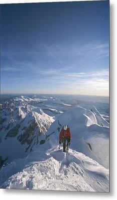 Conrad Anker Summits A Mountain Metal Print by Jimmy Chin