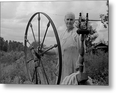 Elderly Woman At Her Spinning Wheel Metal Print by Everett