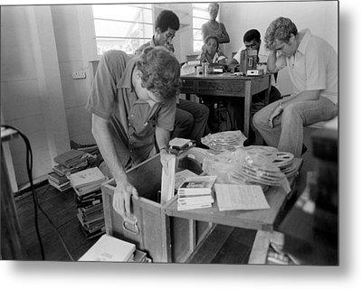 Fbi Agents In Jonestown, Going Metal Print by Everett