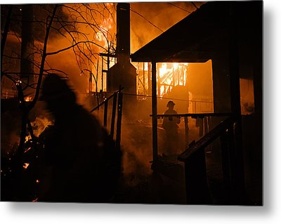 Firefighters Spray Down A Burning House Metal Print by Mark Thiessen