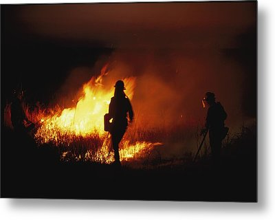Firefighters Start A Controlled Fire Metal Print by Joel Sartore