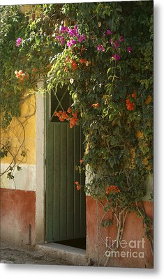 Metal Print featuring the photograph Flower Bedecked Doorway Mineral De Pozos Mexico by John  Mitchell