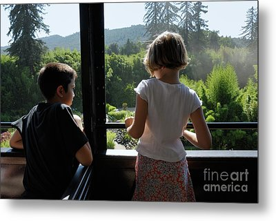 Girl And Boy Looking Out Of Train Window Metal Print by Sami Sarkis