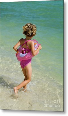 Girl Running Into Water On Beach Metal Print by Sami Sarkis