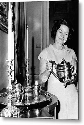 Lady Bird Johnson Holds A Silver Teapot Metal Print by Everett