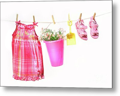 Little Girl Clothes And Toys On A Clothesline Metal Print by Sandra Cunningham