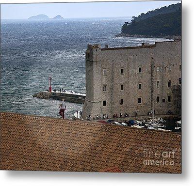 Man On The Roof In Dubrovnik Metal Print by Madeline Ellis