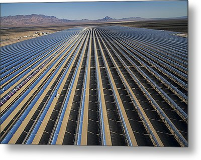 Oil Piped Down Long Rows Of Reflectors Metal Print by Michael Melford