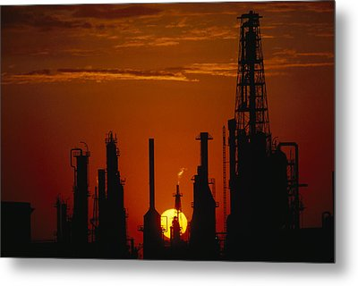 Oil Refinery Silhouetted Metal Print by Paul Chesley