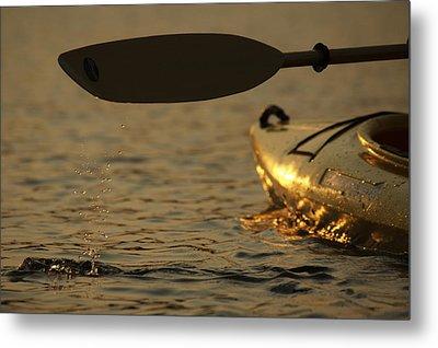 Paddling A Kayak Over Walden Pond Metal Print by Tim Laman