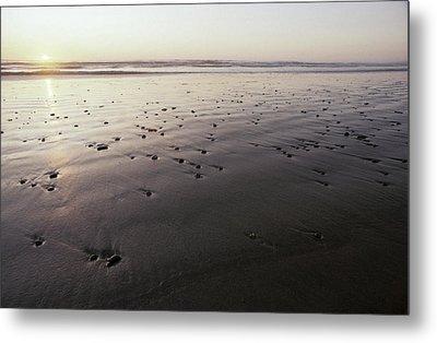 Pebbles Form Patterns On A Sandy Ocean Metal Print by Jason Edwards