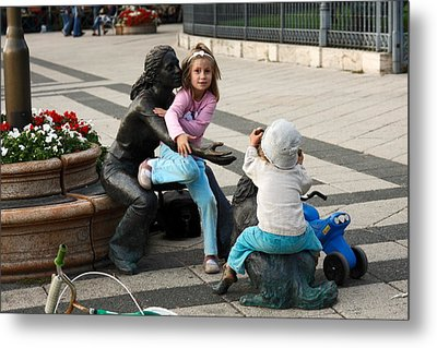 Playing On Sculpture Metal Print by Sally Weigand