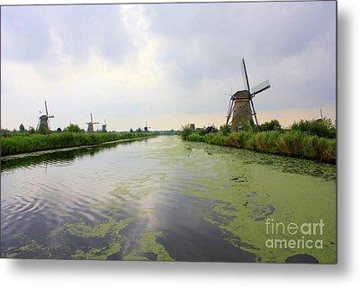 Reflection Of Sky At Kinderdijk Metal Print by Carol Groenen