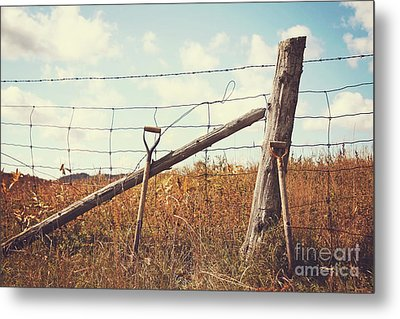 Shovels Leaning Against The Fence Metal Print by Sandra Cunningham