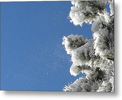 Snow Flakes Against A Blue Sky Metal Print