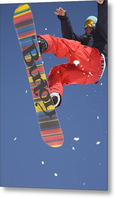 Snowboard Jumping On Vogel Mountain Metal Print by Ian Middleton