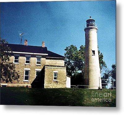 Stone Lighthouse Door County Metal Print by Marsha Heiken