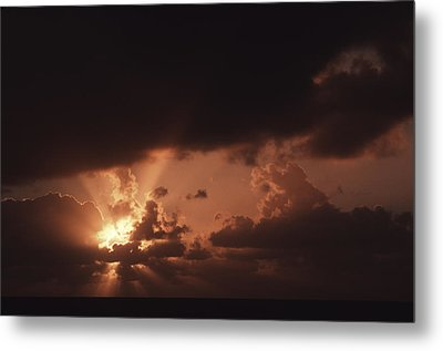 Sunset And Clouds Over Water Metal Print by Ira Block