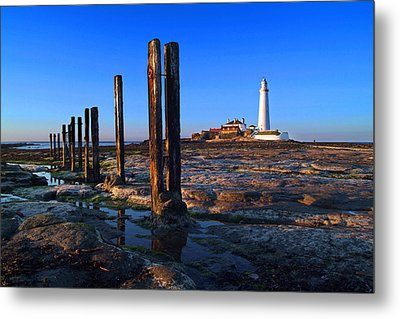 Sunset At St. Mary's Lighthouse Metal Print by Michael Oakes