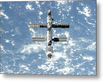 The International Space Station Is Seen Metal Print by Everett