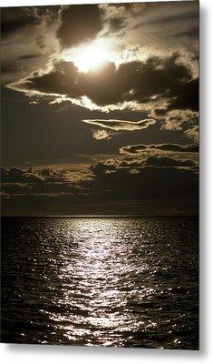 The Setting Sun Pierces A Menacing Metal Print by Jason Edwards
