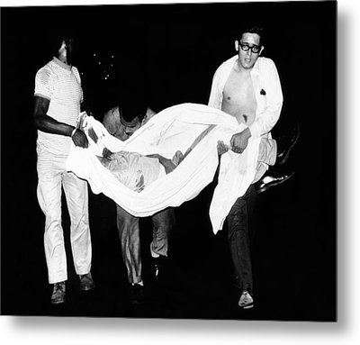 Three Men Carry Body Of A Youth Who Metal Print by Everett