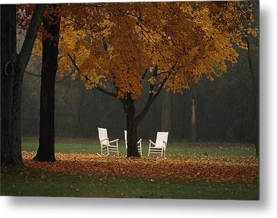 Three Welcoming Rocking Chairs Under An Metal Print by Paul Chesley