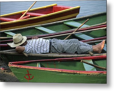 Tour Boat Guide Naps Amidst Rowboats Metal Print by Raymond Gehman