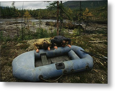 Two Men Use Lung Power To Top Metal Print by Randy Olson