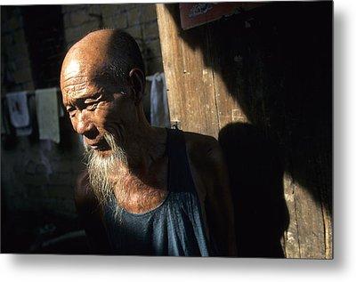 Village Elder At Doorway, Yangdi Metal Print by Raymond Gehman